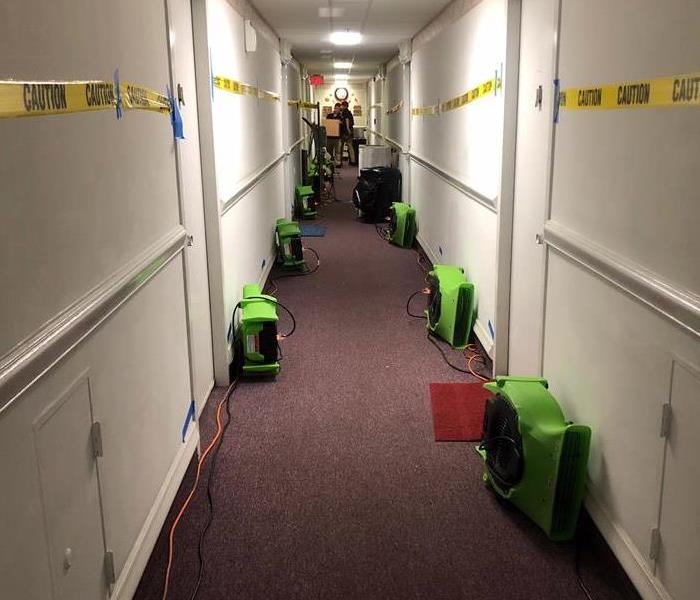 Hallway with green air movers to the side.