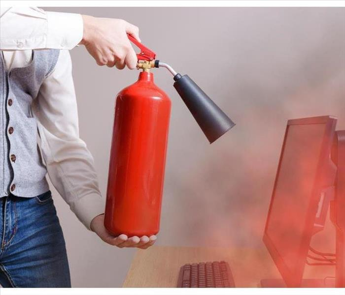 Man using fire extinguisher to stop fire in the office. Concept of protection and security