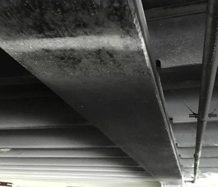 Ceiling of a parking garage with soot damage